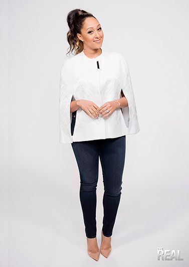Tamera looks runway ready in a Ted Baker cape, Hudson jeans and Christian Louboutin pumps.