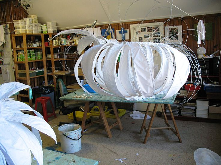Title: Proses van kandelaar maak. Description: This photo shows the process of making the Protea Chandeliers. The wire structure is covered with fine linen and is the painted with a pearlescent glaze.