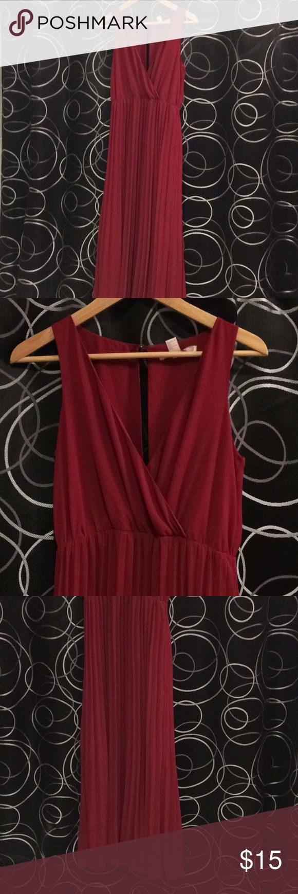 """F21 Burgundy maxi dress formal pleated gown XS Forever 21 brand. Maroon color. Size Contemporary Extra Small (runs one size big) long maxi dress. Cross front shows some sexy but tasteful cleavage. Sits at natural waist. Worn as bridesmaid dress Alongside Lulu's brand Burgundy and red wine gowns. Gently used worn for 4 hours in a wedding. Great for formal dance, prom or date night. Flowy soft polyester chiffon material. Great for dancing. Worn with flats at 5'4"""" and 150lbs. I am usually 4-6…"""