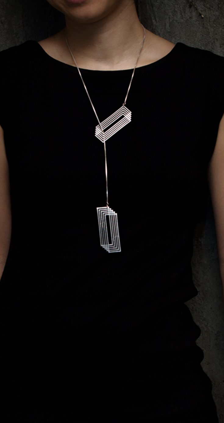 "Necklace | Yumi Endo  ""Cut"".  Stainless steel, sterling silver box chain"