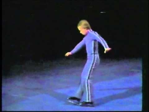 "Scott Hamilton demonstrates in History of the ""Figure"" part of Skating: 1984 Winter Olympics - Men's Figure Skating Compulsory Figures - Part 1"