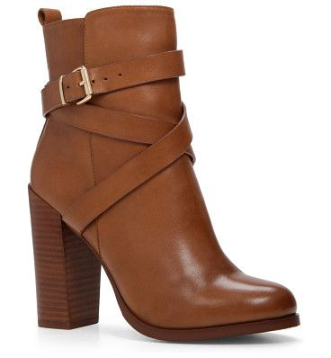Elassa boots by ALDO. Tough and lovely: a block heel and buckles firm up your fashion statement. - Zip boot. - Round toe. - Single sole. - ...