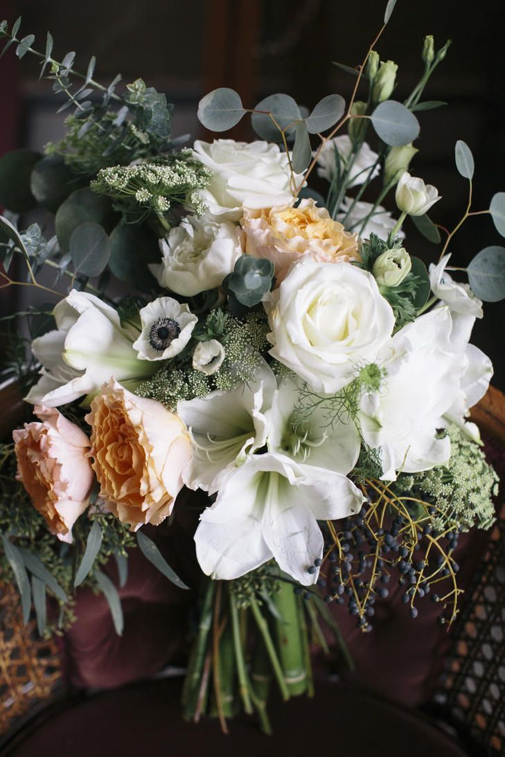 Lush, Textured Bridal Wedding Bouquet With Peach and White Anemones, Roses, Amaryllis, Eucalyptus and Berries | Photo: Kate Preftakes Photography | Bouquet: Flower Kiosk |