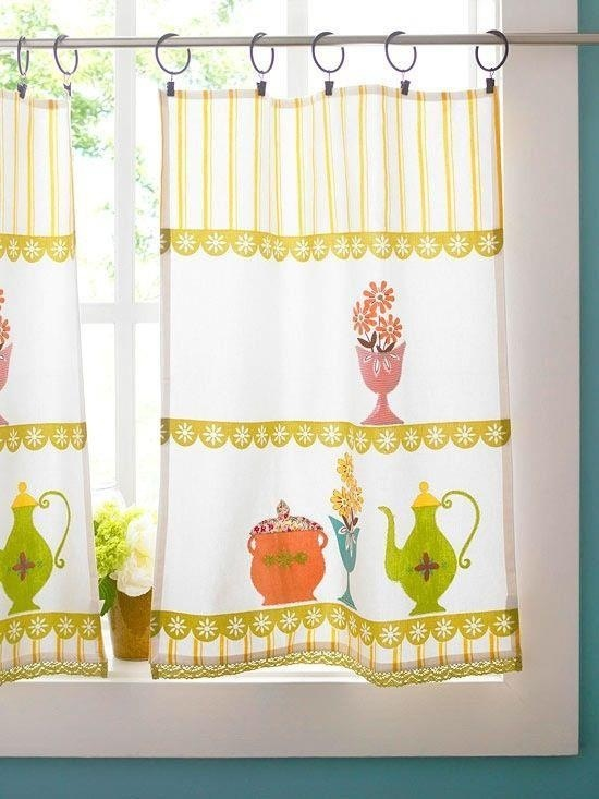 Vintage tea towels used as curtains. LOVE this idea!