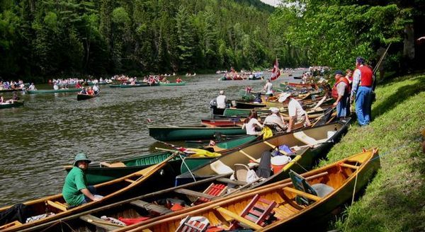 This is epic!! I hope I can witness this festival at some point in my lifetime!! People canoeing down the river and playing fiddles! Fiddle music is the best; it makes me so incredibly happy!