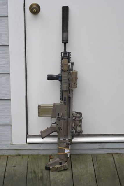 With sound suppressor and vertical foregrip. This is a Mk 17 SCAR-H 7.62mm.