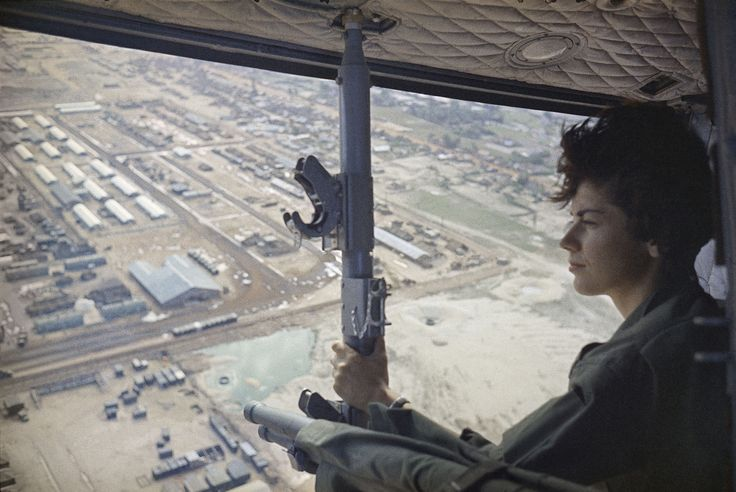 The Army nurse 2nd Lieutenant Roberta Steele, 23, looks out from a medical helicopter with a hospital below in Qui Nhon, South Vietnam, on February 9, 1966.