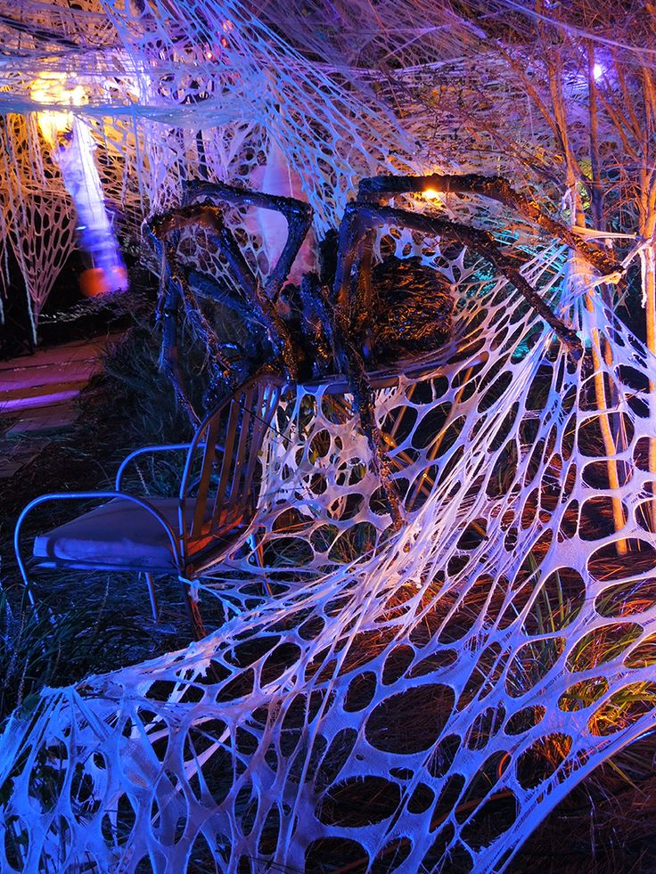 "Mitchell's Halloween 2013... ""side view of one of our hand-made spiders. It is about 5 foot wide! LOVE using the beef-netting spider's web!"" OMG those spiders are freaky! In a great way! #yardhaunt http://www.howtohauntyourhouse.com"