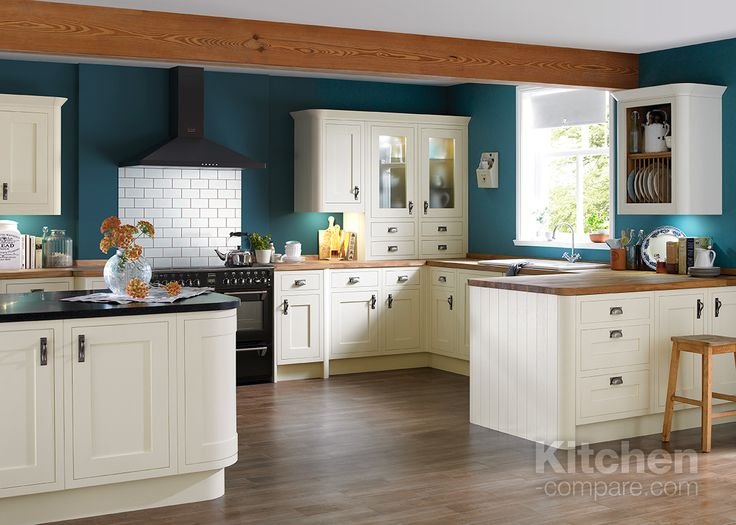 B&Q Cooke & Lewis Carisbrooke White. The Carisbrooke White Framed kitchen is created with storage in mind. From built-in wine racks and open shelved crockery holders, this beautiful design has a wide choice of storage options for busy family life.  Visit our website to compare other shaker kitchen styles - http://bit.ly/1RQKVha