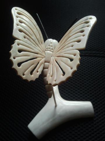 Inuit made butterfly in caribou bone w/ baleen antennae by Lucas Attagutsiak