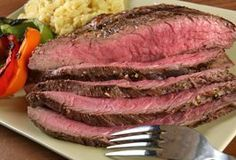 London broil is actually a cooking method rather than a cut of meat. Butchers commonly label several cuts of meat as London broil, however, so the slab of beef in your refrigerator is likely a top round roast or flank steak. These cuts tend to be tough when cooked quickly, but smoking a London broil cut produces a tender, juicy dish. One key is to...