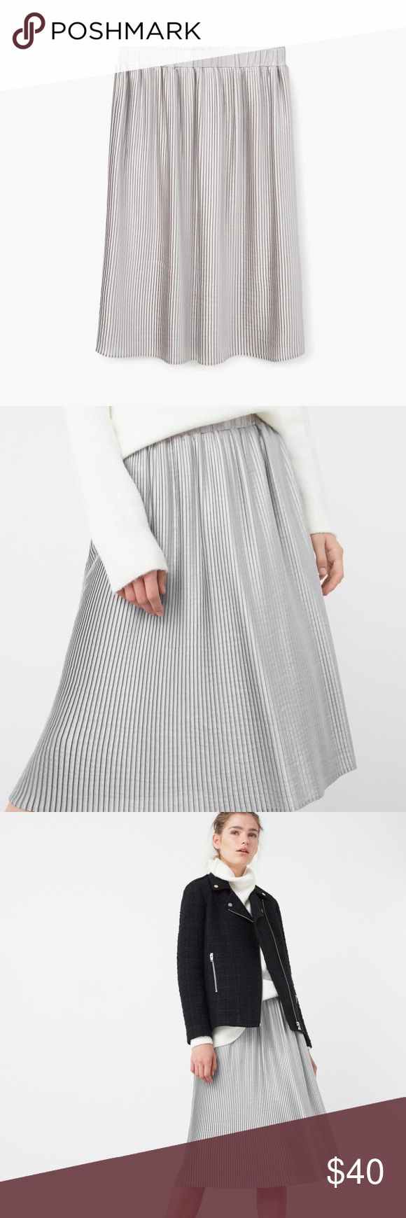 Mango Pleated Midi Skirt in Metallic Gorgeous pleated skirt - Wear with a chunky sweater and ankle boots for a super trendy fall look - Elastic waistband - Fully lined - Condition: Perfect, no holes, stains, or any signs of wear - Care: Hand wash and fry flat - Measurements: Waist: 13 3/4'', Length: 27'' - Smoke free, pet free home. Mango Skirts Midi
