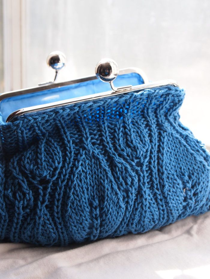 Free Knitting Pattern for Leafy Clutch - Leaf clutch created by knitting two panels and sewing them together. Add a purse frame and lining to give your clutch a finished look.
