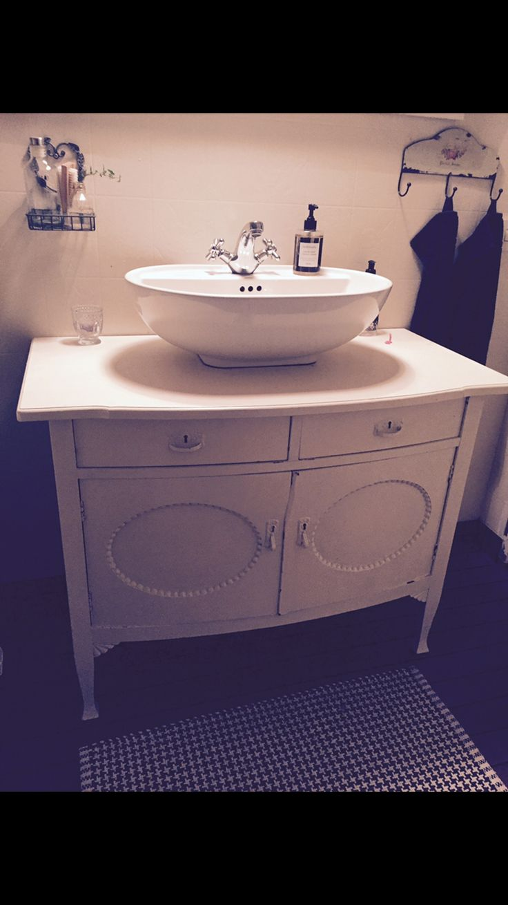 An old cabinet became a beautiful washstand.