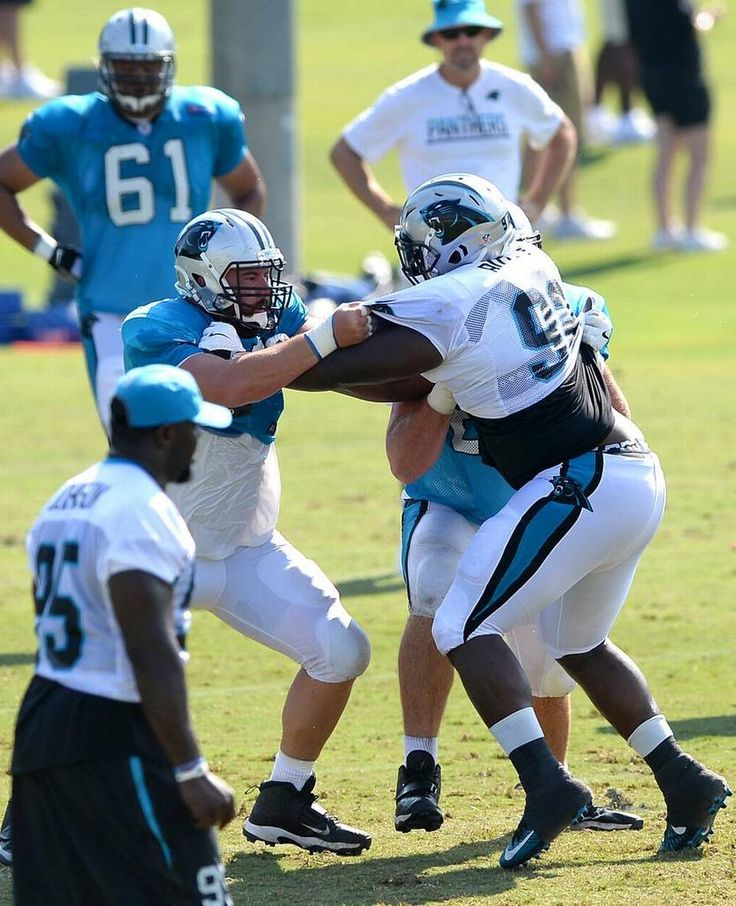 Carolina Panthers center Ryan Kalil, left, and guard Andrew Norwell, not visible, battle defensive tackle Vernon Butler, right, during practice…