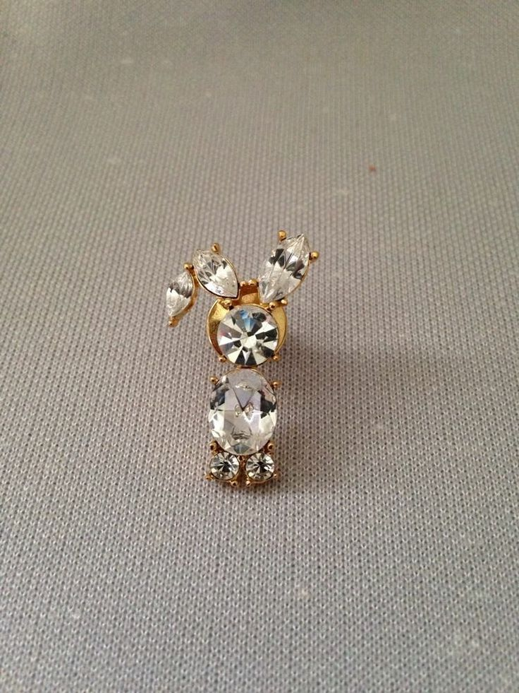 Cute unsigned gold tone lapel pin, tie tack with rhinestones in a rabbit design!