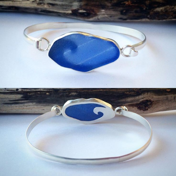 Sterling silver bracelet with blue sea glass that has a wavy texture to it! Also has a wave design cut out on the back