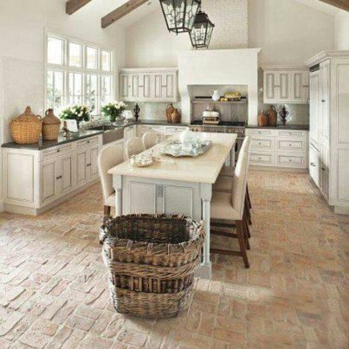 Brick or recycled cement tile/pavers for the kitchen floor. Just sweep,vacuum, or mop. Super durable and hides kitchen debris well.