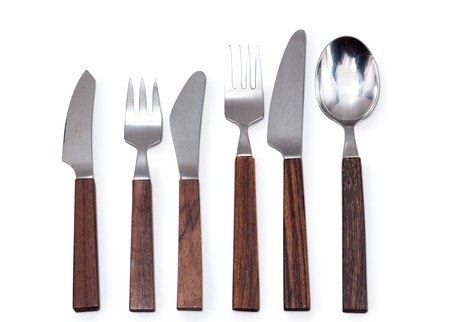 Bertel Gardberg 1916-2007  FLATWARE, 41 PIECES.  Triennale, 6 spoons, 6 forks, 6 knives, 12 small forks, 5 small knives and 6 fruit knives. Design 1956-57. Stainless steel and palisander. Manufactured by Fiskars.