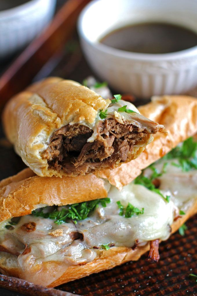 Slow Cooker French Dip Sandwiches are incredibly juicy, tender and so flavorful. Perfect for a delicious dinner and the best quick and easy party food.   Peas & Peonies