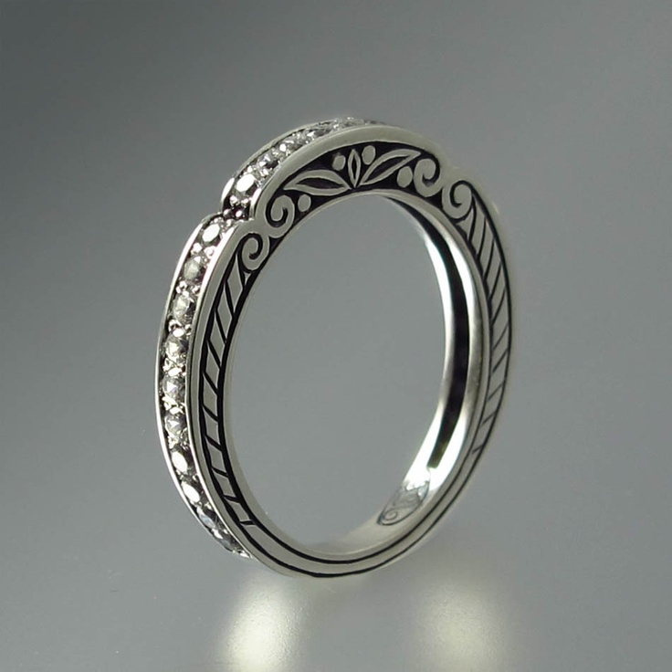 Im not a jewelry girl, but i would totally wear this. stunning. CARYATID wedding band in sterling silver with white by WingedLion, $345.00