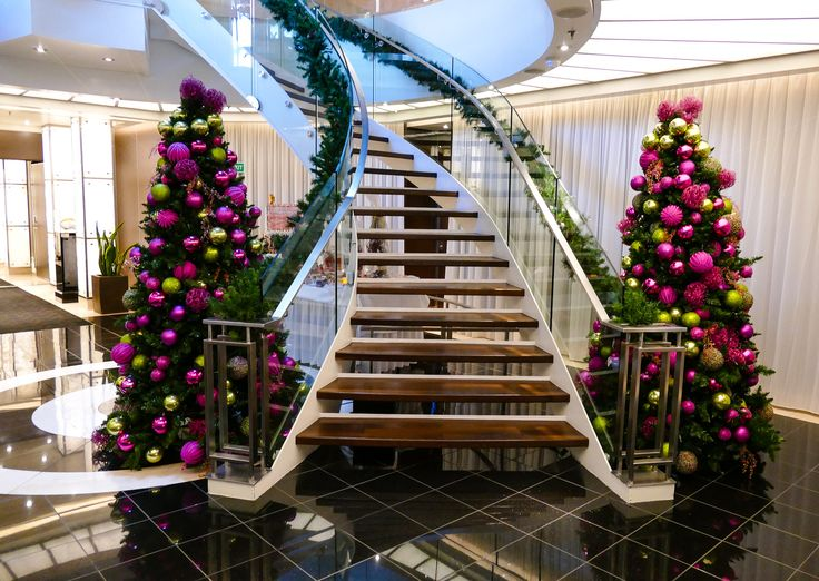Christmas trees decorate the Seabourn Quest atrium on a luxury cruise ship Christmas.