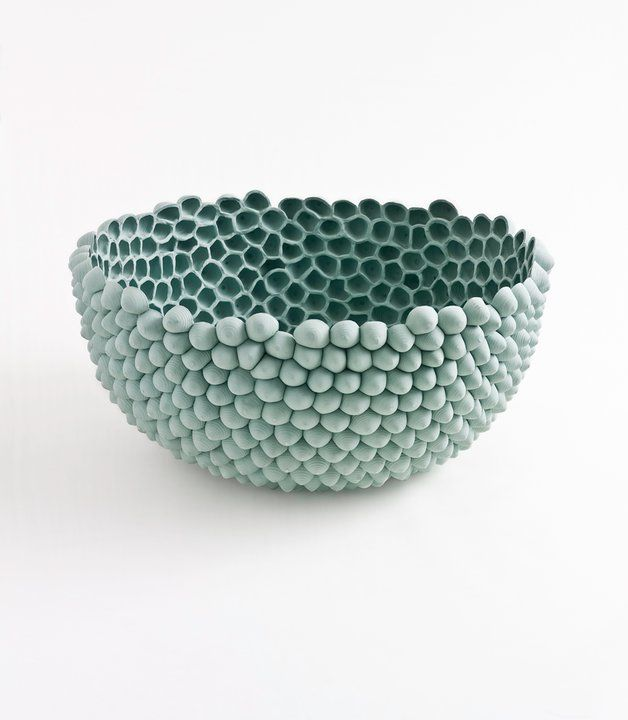 Not interested in the hollow insides, but love the idea of a bowl made up of small balls of clay :-)
