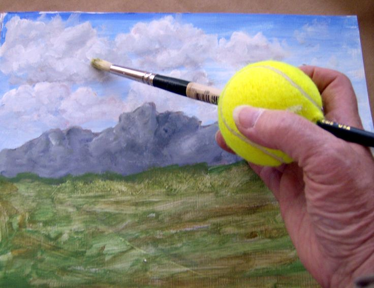 Put paintbrush through tennis ball - for individuals with special needs, arthritis/carpal tunnel...