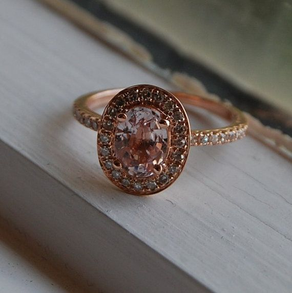 1.6 ct Peach Champagne Sapphire in 14k rose gold.  Such a gorgeous combination!   A gorgeous alternative to a diamond for under 2k!