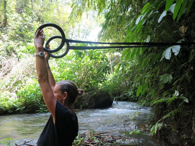 The rings are always in the backpack on our jungle treks. Pilates inspired moves at the river challenges your balance whilst the water cools you down.  http://www.sharingbali.com/bootcamp/general-fitness/