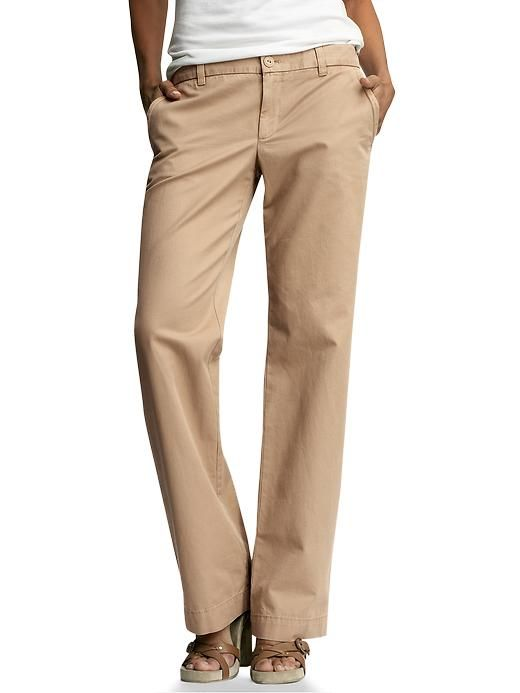 Khaki pants look great when paired with a forest green sweater (try a v-neck for a classic look), or cotton shirt. Alternatively, try wearing khaki and white and introduce forest green through a .