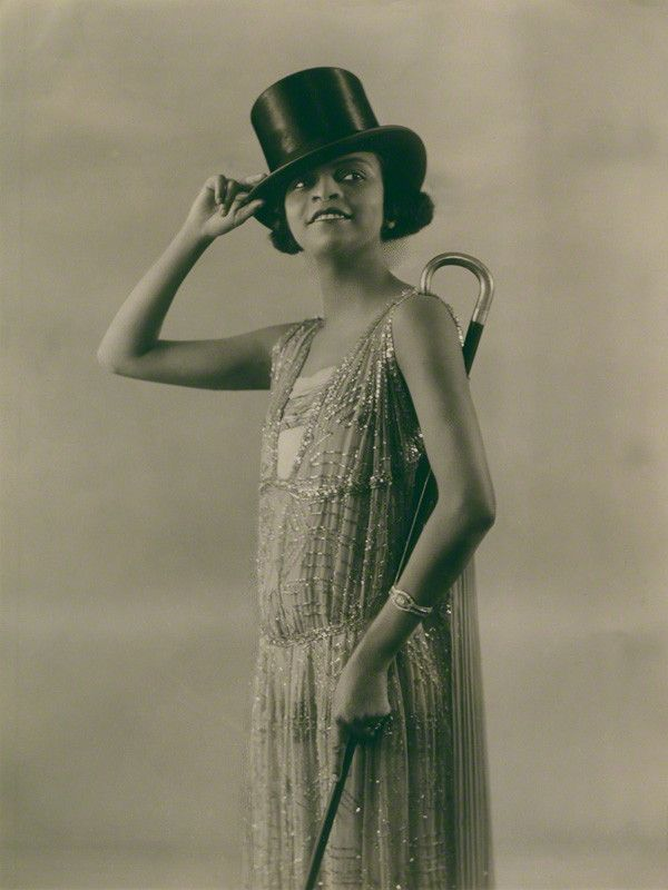 """One of the earliest Black superstars, singer Florence Mills (1896-1927) on August 1, 1923 in """"Dover Street to Dixie"""" at the London Pavilion. Best known as the lead in the first all-black Broadway musical, """"Shuffle Along"""" in 1921, Ms. Millssudden death in 1927 at the height of her popularity devastated her friends and fans in the United States and Europe. An estimated 150,000 people lined the streets of Harlem to mourn her passing. Photo: Bassano/National Portrait Gallery, London."""