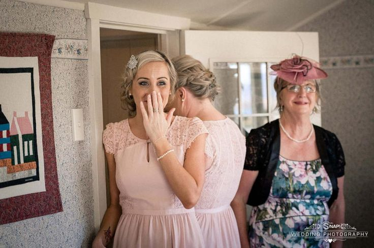 Bridesmaid is taken aback by the bride's beauty after seeing her for the first time in her wedding dress. Check out other wedding photography by Anthony Turnham at www.snapweddingphotography.co.nz