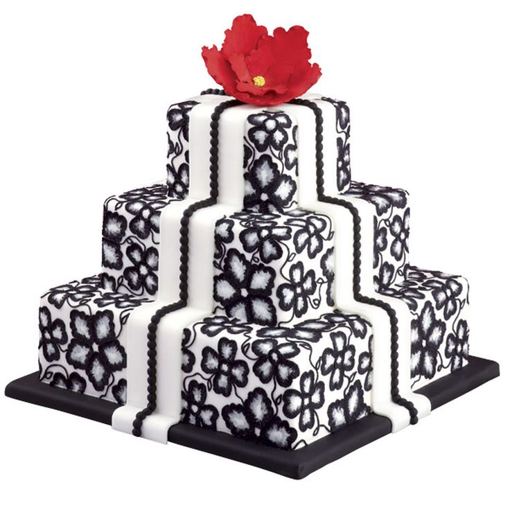 A classic black and white cake is the perfect centerpiece to an elegant wedding reception. Using the brush embroidery technique, this Petal Impressions Wedding Cake features a lovely lacy design, achieved by using a food-safe brush to add detail to the flower petals. Top your cake with an edible gum paste flower for a beautiful crowing touch. Large enough to serve about 150 guests, this Petal Impressions Wedding Cake is suitable for any wedding theme any time of year.