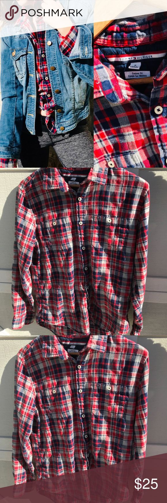 """90s  Tommy Hilfiger Plaid Flannel Button Up Men's but I wore it anyway as a lady, so it's boxy but soooo comfy! Red and blue plaid, Signature Tommy buttons and label everywhere. Super soft. 25"""" long. I love wearing it tied  up and styling it with a denim jacket and black ripped jeans. 100% cotton. Tommy Hilfiger Tops Button Down Shirts"""