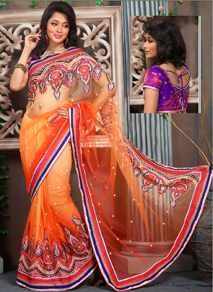 You Will Be The Center Of Attention In This Attire. All Of This Accenting The Feminine Beauty, With This Deep Orange & Tomato Net Saree. This Ravishing Attire Is Amazingly Embroidered With Bead,Gold Zardosi,Lace,Resham,Stones,Swarovski Work.