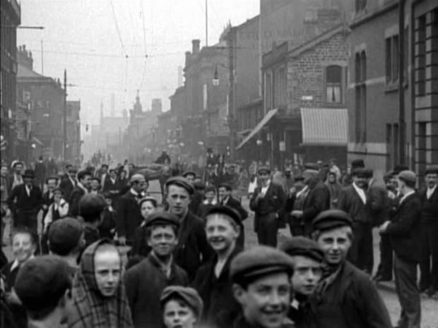 CAPPED: Headgear was to the fore in this picture of Darwen Street, Blackburn, in 1902