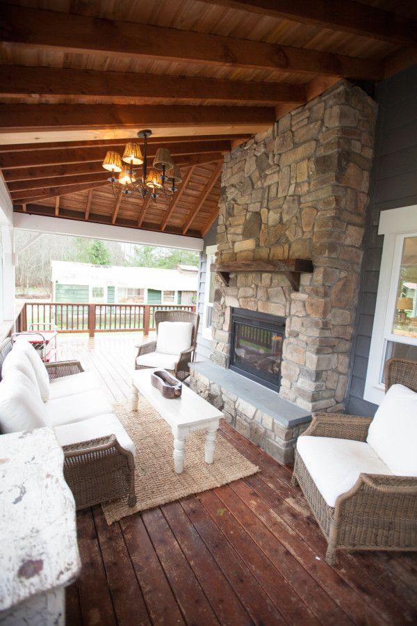 Covered Porch Stone Fireplace Outdoor Wicker With White Cushions L Keller Farmhouse