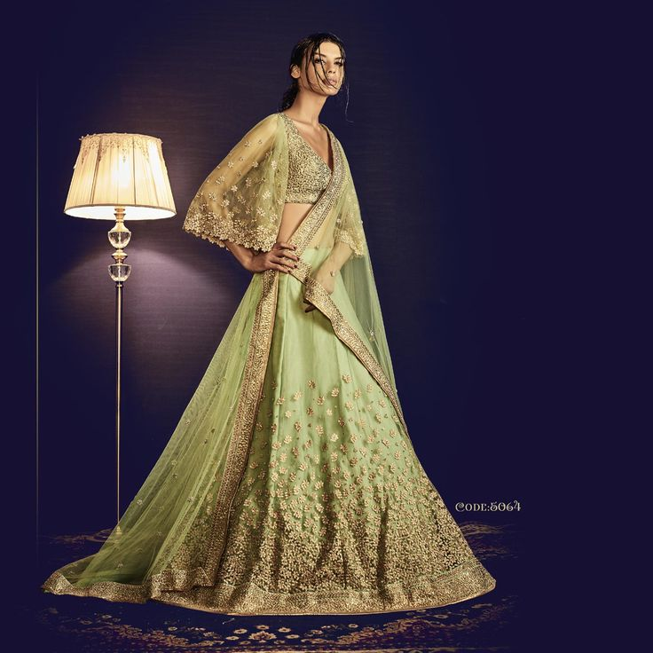 Light Green Heavy Embroidery Bridal Wedding Lehenga Saree in Net Fabric. Buy Now :- https://goo.gl/104Tid #CashOnDelivery & #FreeShipping available in India.