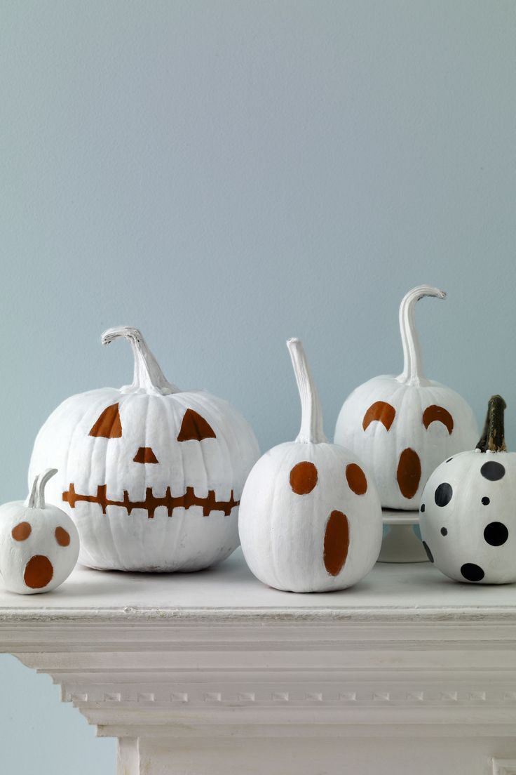 Paint your pumpkins. Paint—don't carve—your pumpkins for a chic and simple…
