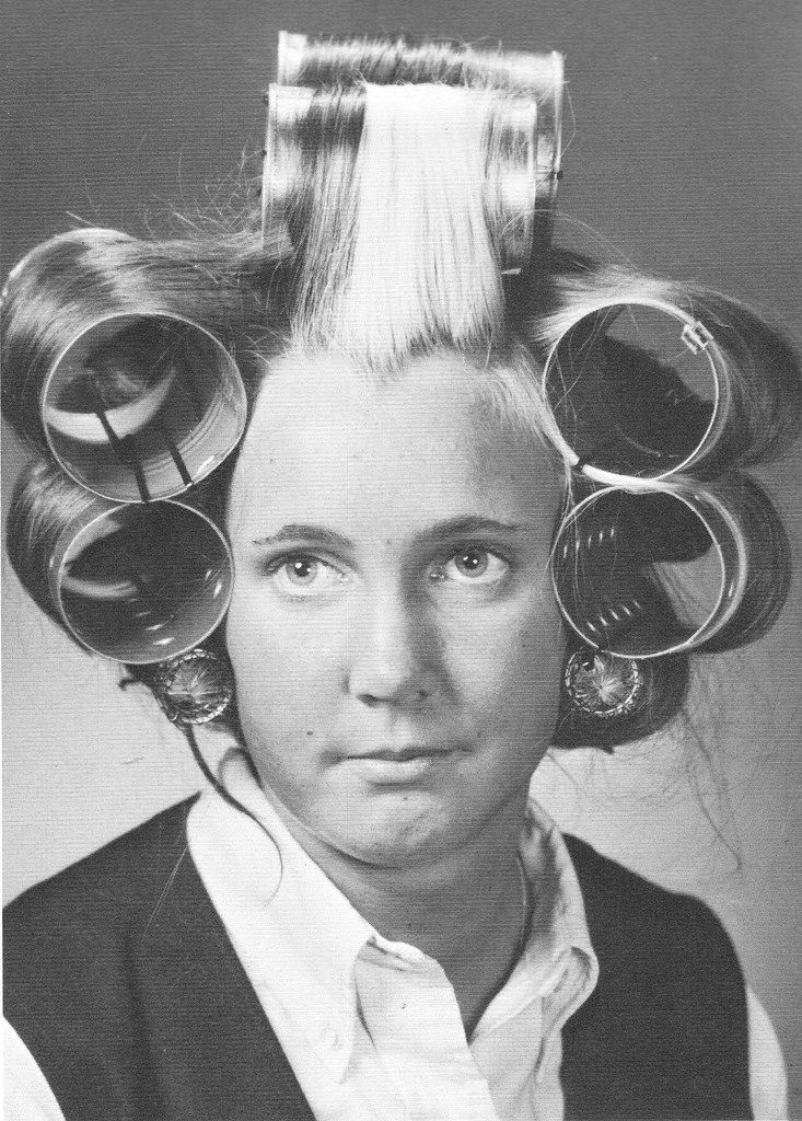 Young girl and soup can sized rollers, 1967