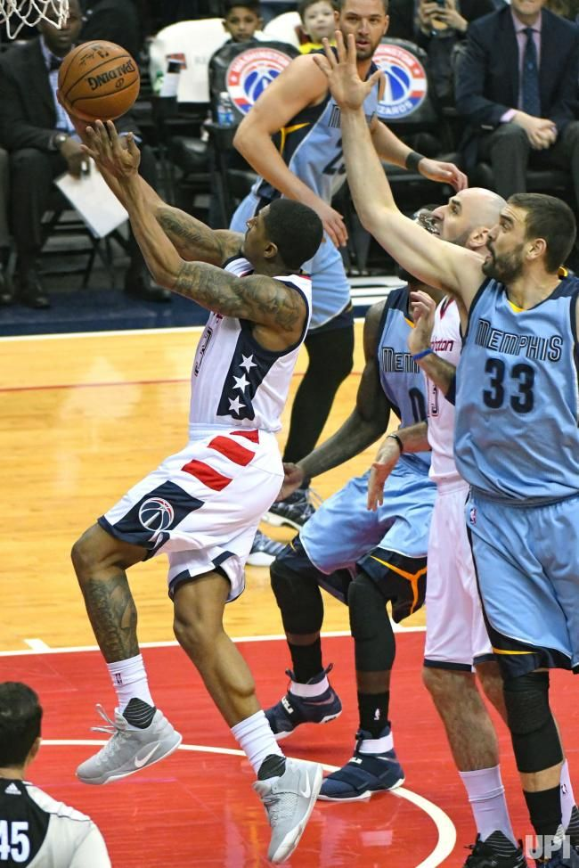 Washington Wizards guard Bradley Beal (3) scores in the first half against Memphis Grizzlies center Marc Gasol (33) at the Verizon Center…