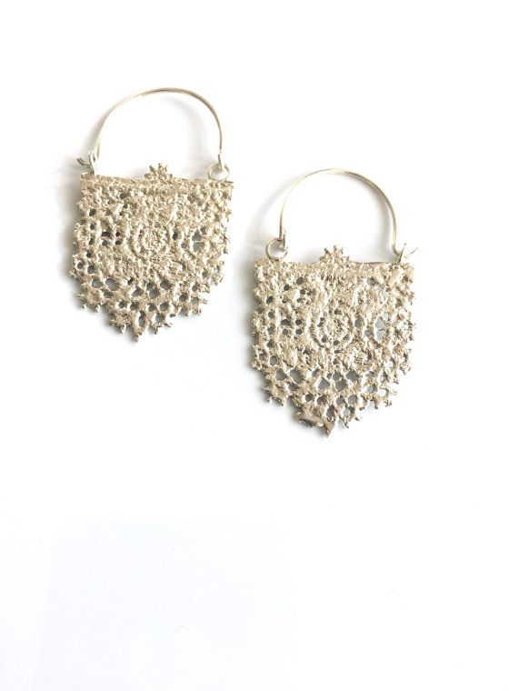Made from cast lace these earrings capture the look and feel of genuine lace They are surprisingly lightweight! Perfect with a casual or a dressy outfit Would look gorgeous on a bride! These earrings are not dipped They are 100% sterling silver They hang approx 2 inches in length