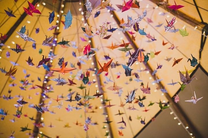 origami planes, unexpected original idea for above the dance floor at the reception
