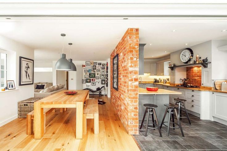 American-style kitchen-diner with exposed brick wall