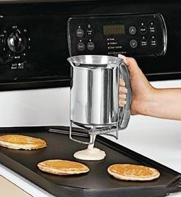 """Batter Dispenser  Product #: JB4672  Price: $19.98        Just squeeze the easy grip handle to start and stop the flow of batter. Stainless steel dispenser comes with a built-in stand so no mess, drips, or fuss and a lot less to clean up! Holds 28 ounces. (6-1/4""""H x 4-1/4""""Diam.) http://katherinel.shopregal.ca"""