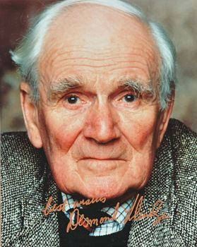 "DESMOND LLEWELYN: Striking color photo signed by Desmond Llewelyn, a British actor most well known for his role as ""Q"" in the James Bond film series."