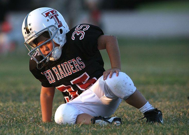 #american #cute #expression #fall #fallen #football #football field #frustrated #grass #green #helmet #kid #little #overwhelmed #player #sad #struggling #texas #uniform #youth league