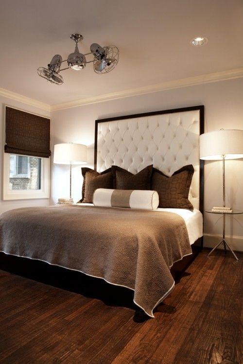 Brown and white bedroom with a stunning modern suspension lamp