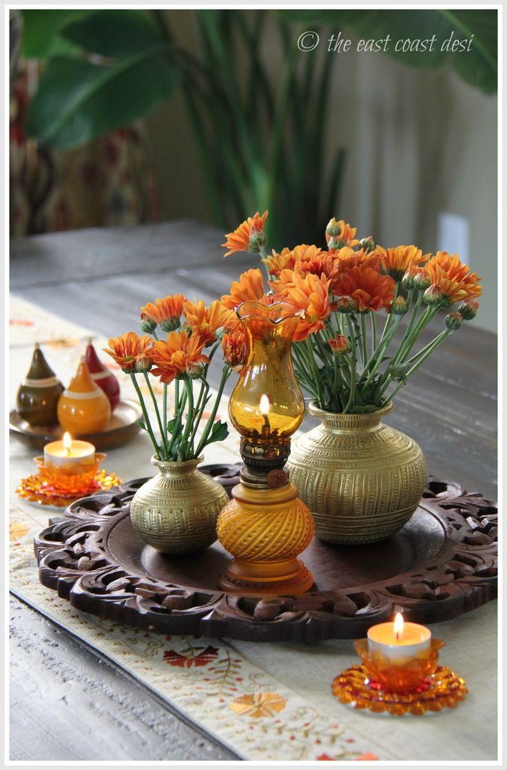 Ornate plate charger, vintage colored lamps, brass pots with mums (Styling by Sruthi Singh of The EAst COast Desi) - diwali decor ideas